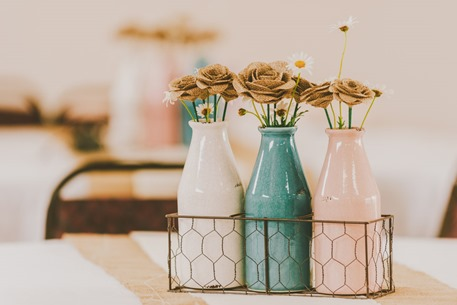 wedding flowers in vases on tables