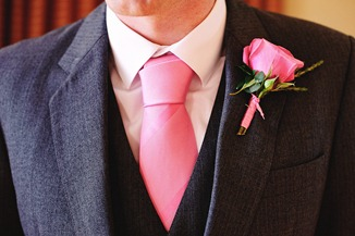 Groom pink tie button hole