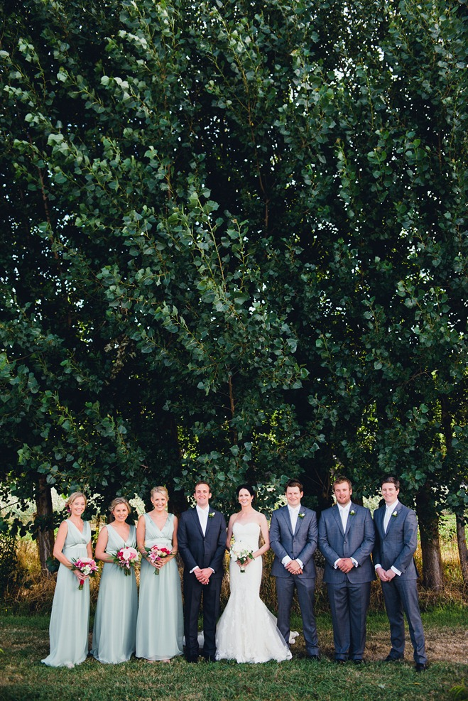 wedding photos in front of tall trees
