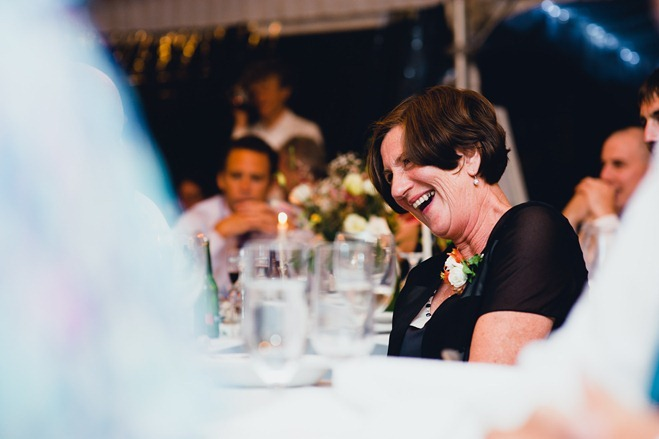 wedding guest erupting with laughter