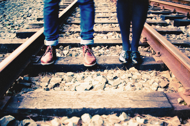 Vintage travel themed train station railyard engagement photo shoot in Wellington