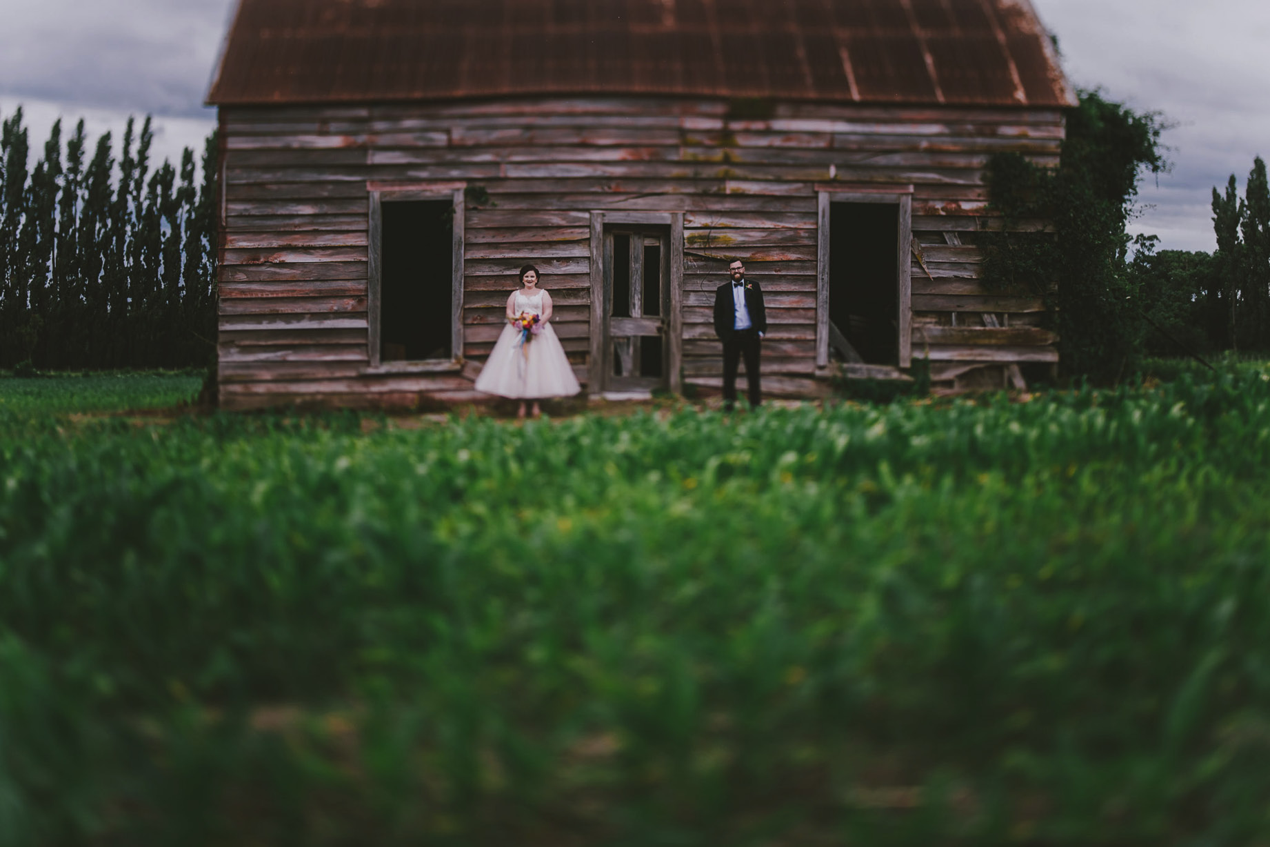 Featherston Wairarapa wedding photos of couple in front of barn